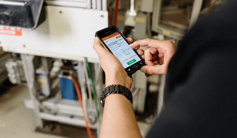 An Osram worker looking at his mobile Ticket Manager.